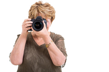 senior female amateur photographer taking photos