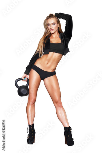 Sexy blonde fitness woman with kettlebell