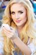 Beautiful blonde girl talking by phone