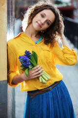 Happy young woman with bouquet of flowers