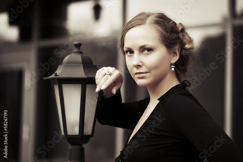Beautiful woman at lamppost
