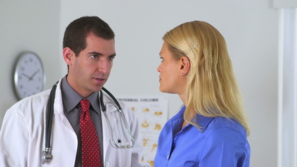 Male doctor advising female patient