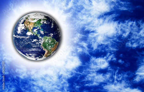 The Earth with light beam and sky in background