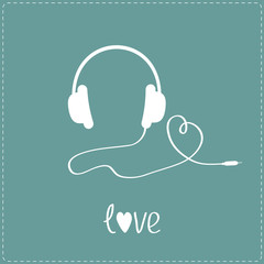 White headphones and cord in shape of heart.  Blue background.