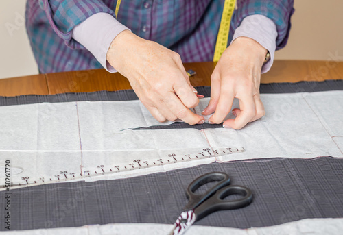 Dressmaker design tailor pattern on the table