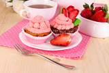 Beautiful strawberry cupcakes and flavored tea