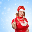 Woman in santa suit on snowfall background
