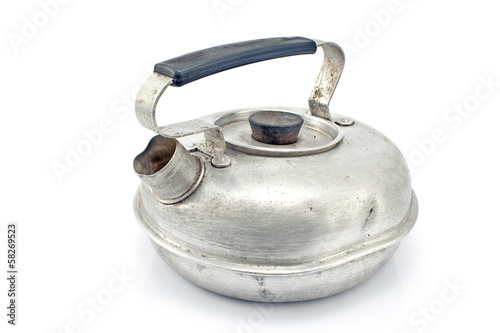 Old aluminum teapot isolated on white