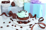 Tasty cupcake with gifts close up - 58270591