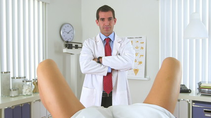 Male gynecologist standing in front of woman