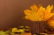 Beautiful autumn leaves in wooden vase