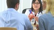 Japanese doctor explaining heart condition to couple