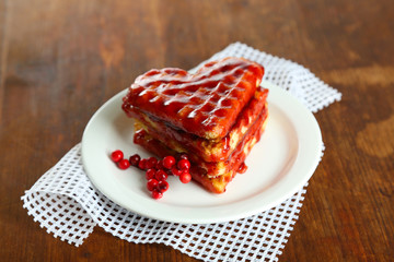 Sweet Belgium waffles with jam, on wooden table background