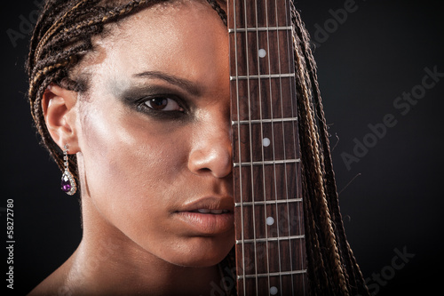 Portrait of a african american woman with dreadlocks hair with a