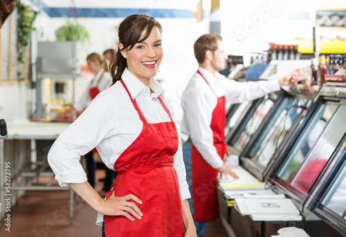 Confident Butcher Standing At Store - 58272795