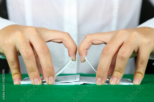 Playing cards in hands close up