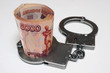 Banknotes and metal handcuffs