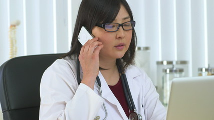 Japanese doctor talking on the phone