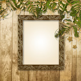 Christmas background with a gorgeous garland and frame for photo