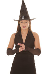 Witch look down hands together