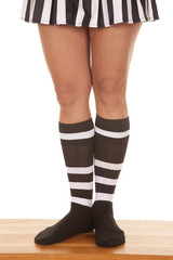 Woman referee legs together