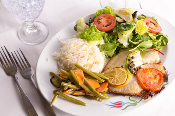 Tilapia Cooked with Capers Lemon and Tomatoes Served with Vegeta
