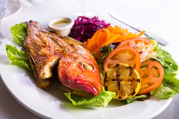Full Cooked Tilapia Served with Vegetables and Fish Sauce
