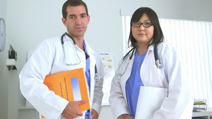 Two doctors standing in the office