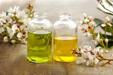 bunch of spring flower, massage oil on board