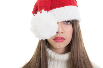 Cute Santa teenage girl posing with one eye covered