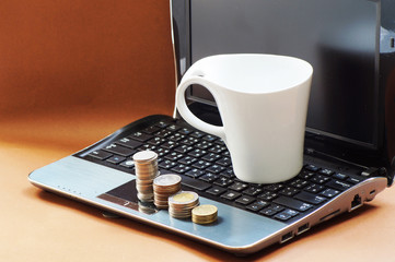 white cup and money on notebook
