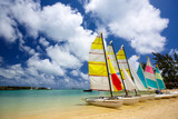 Beach with sailboats in Mauritius Island