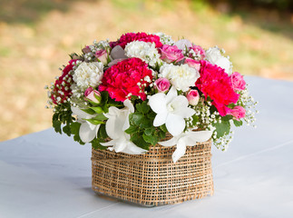 beautiful bouquet of bright wildflowers in basket