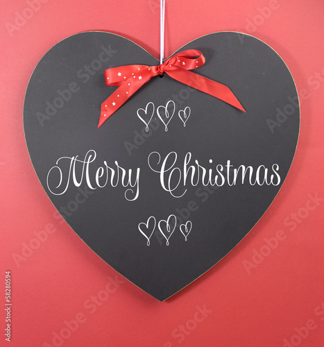 Red Merry Christmas greeting on heart blackboard