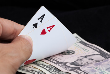 two aces and bank note