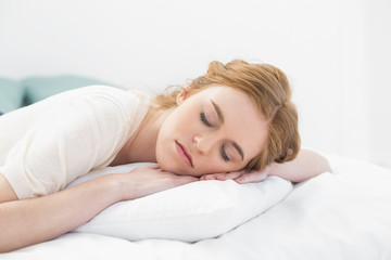 Close up of pretty young woman sleeping in bed
