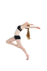 Side view of a sporty young woman stretching