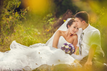wedding couple portrait on a meadow, summer nature outdoor