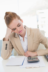 Tired young businesswoman resting at office desk