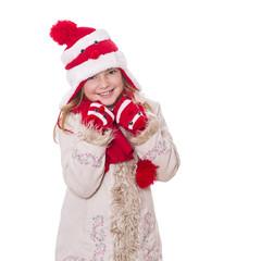 Mädchen im Wintermantel mit Pudelmütze und Schal