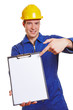 Construction worker pointing to empty clipboard