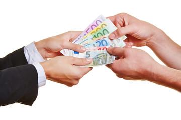 Hands pulling on Euro money bills