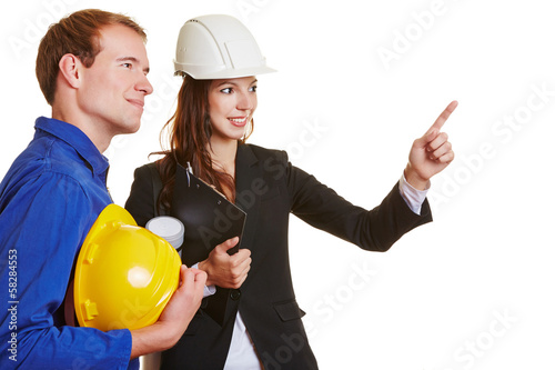 Construction worker and architect working together