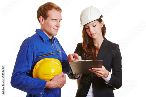 Worker and engineer with clipboard