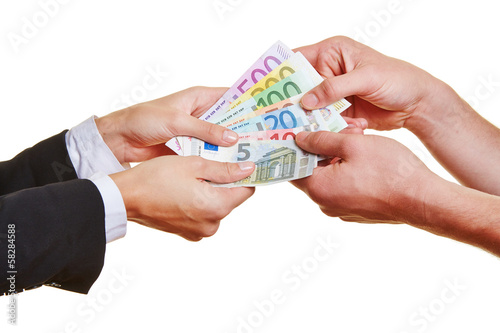 Hands pulling on Euro money bills