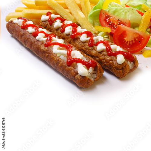 Colourful serving of spicy grilled meatball Frikandel