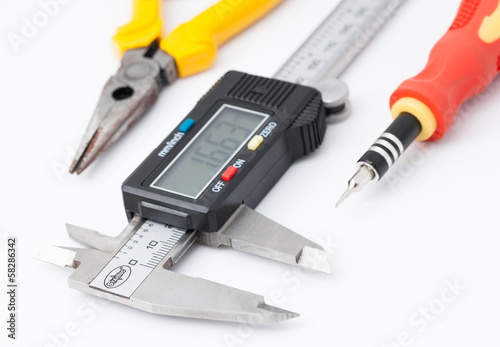 Electronic caliper, Pliers and Screwdriver on white background