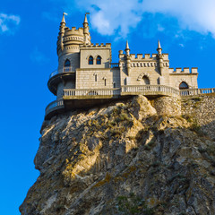 Medieval castle agains blue sky with clouds. Swallow's Nest\