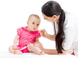 doctor giving drug to baby girl
