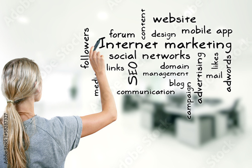 woman writing internet marketing concept keywords